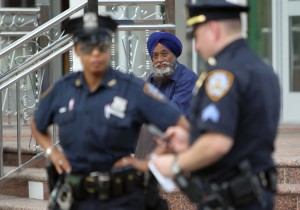 Police increase their presence at the Sikh Cultural Center in Richmond Hill Queens in New York on 6 August 6. The extra security is in response to a shooting the at the Sikh Temple of Wisconsin in Oak Creek Wisconsin on 5 August that left seen people including the suspected shooter dead and three injured AFP PHOTO/ Mehdi Taamallah