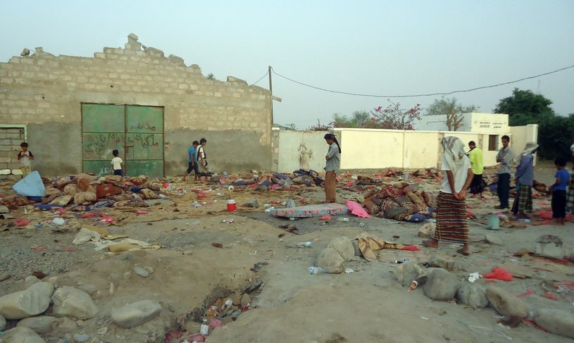 Onlookers gather at the scene of a suicide bombing in the restive southern province of Abyan on 5 August. The suicide attack blamed on Al-Qaeda in Jaar, one of a string of towns in Abyan province that were retaken by government troops in June after being held by Al-Qaeda loyalists for more than a year, killed 45 people, local officials said, as residents voiced fears that a lack of security personnel on the ground will allow the jihadists to return AFP PHOTO / STR