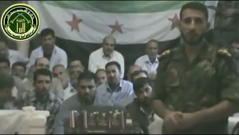 An image grab taken from a video uploaded on YouTube on 5 August 2012 allegedly shows footage of Iranians (background) kidnapped in Damascus, in which a rebel fighter alleges the hostages are elite Revolutionary Guards