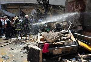 A handout picture released by the Syrian Arab News Agency (SANA) shows Syrian firefighters extinguishing a fire following at the site of a car bomb that ripped through Jaramana, a mainly Christian and Druze suburb of Damascus, on September 3, 2012. AFP PHOTO/HO/SANA