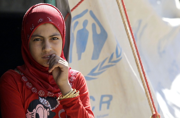 Refugee waits in a camp on the Jordan side of the border with Syria AFP PHOTO / KHALIL MAZRAAWI