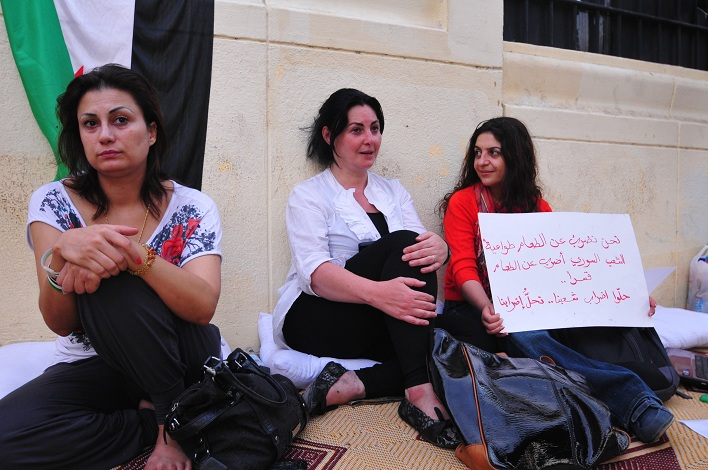 Syrian women protesting outside of the Arab League building in Cairo Hassan Ibrahim / DNE