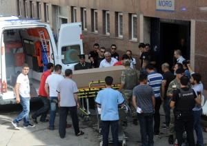 Turkish soldiers and medics unload the coffin of a slain Turkish soldier to a hospital in Beytussebap on 3 September. Kurdish rebels wielding rocket launchers and machine-guns attacked a security base in southeast Turkey, triggering a firefight that left 30 people dead AFP PHOTO