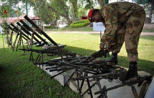 A Pakistani army soldier arranges seized weapons and ammunition in Peshawar on 29 August after a military operation against militants in the country's lawless tribal northwest AFP PHOTO/Hasham AHMED