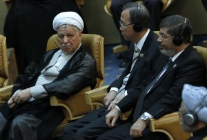 Egyptian President Mohamed Morsi (right), UN Secretary General Ban Ki-Moon (centre) and Iran's former president Akbar Hashemi attend the Non-Alligned Movement summit in Tehran AFP PHOTO / MEHR NEWS / RAOUF MOHSENI