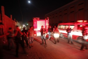 Ambulances and firemen arrive following an Israeli air strike in Gaza City on 28 August AFP PHOTO/MOHAMMED ABED