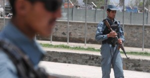 Afghan policemen stand guard at a checkpoint in Kabul (File photo) AFP PHOTO