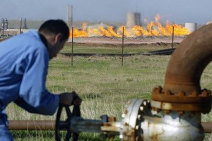 An oil worker tending to a supply pipeline in Iraqi Kurdistan AFP PHOTO