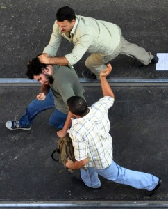 Scenes from the human rights past of Egypt: plain clothed policemen arrest a political activist during a protest in the Mediterranean city of Alexandria on 21 September 2010 AFP PHOTO / Stringer