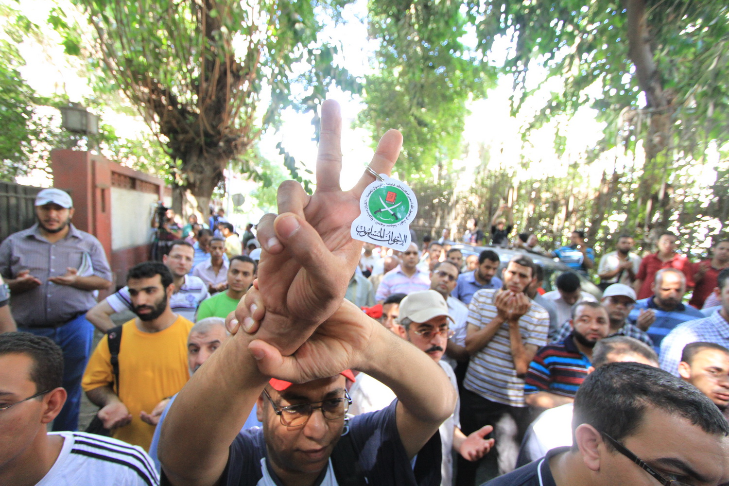 Protester carries a key ring with the Muslim Brotherhood symbol during protests in front of the Syrian embassy in Cairo Mohamed Omar