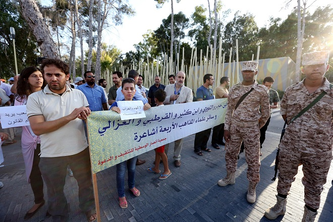Libyans protest in Tripoli on 27 August to urge the newly-elected parliament to intervene to protect the national heritage after Islamist hardliners destroyed shrines across the country AFP PHOTO / MAHMUD TURKIA