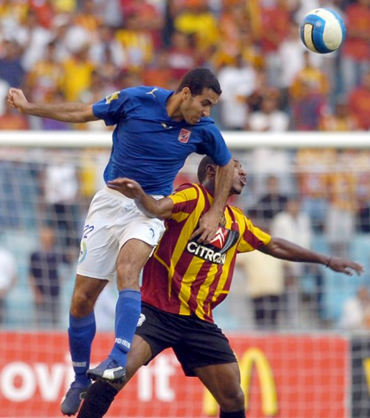 Abu Treika leaps up to head the ball (File photo) AFP PHOTO
