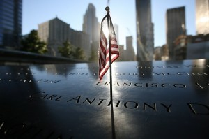 US flag stands at memorial of the north tower during observances on the eleventh anniversary of the attacks on the World Trade Center in New York AFP PHOTO/CHRIS PEDOTA / POOL