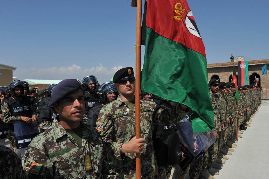 One day after Afghan National Army soldiers took part in a ceremony to mark the handing over of Bagram prison to Afghan authorities, the air base where it is situated was struck by several missiles AFP PHOTO / SHAH MARAI