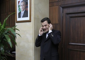Turkish national Aydin Tufan Tekin phones after being handed to the Turkish Ambassador to Lebanon at the Lebanese General Security headquarters in Beirut on 11 September AFP PHOTO / ANWAR AMRO