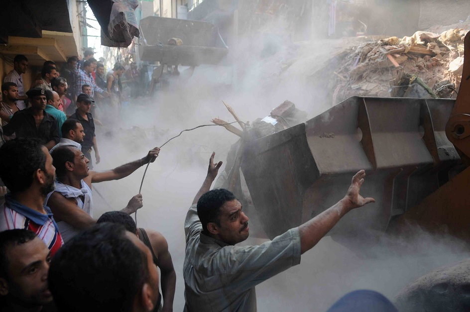 Workers begin to clear the rubble from the collapsed apartment building in the Shubra district of Cairo Mohamed Omar