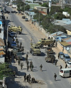 Somalia policemen gather at the area of a bomb blast at the Jazeera hotel compound where the newly elected Somali president Hasan Sheikh Mahmud was staying, in Mogadishu AFP PHOTO/SIMON MAINA