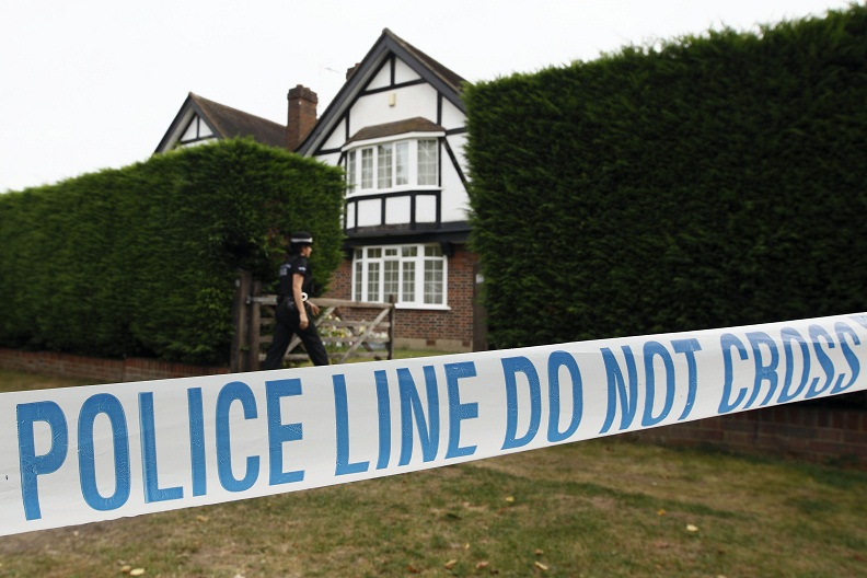 British police stand outside the home of Saad and Iqbal al-Hilli in Claygate, in Surrey, south-east England AFP PHOTO / JUSTIN TALLIS