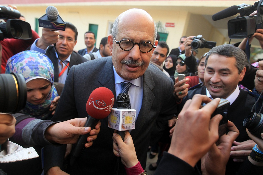 Mohamed ElBaradei, interim leader of the new Dostour party, leaves a polling station after voting in the 2011 parliamentary elections (File photo) AFP PHOTO / KHALED DESOUKI