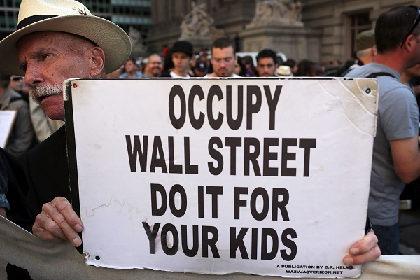 A protester with 'Occupy Wall Street' holds up a sign during demonstrations in New York City. The 'Occupy Wall Street' movement, which sparked international protests and sympathy for its critique of the global financial crisis, is commemorating the first anniversary of its earliest protest. AFP PHOTO / Spencer Platt
