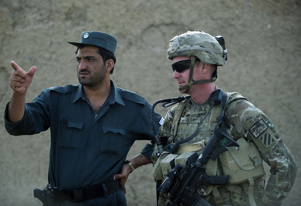 US Army Lieutenant Jameson Bligh looks on as he consults with a member of the Afghan National Police during a joint patrol in Kandahar province (File photo) AFP PHOTO / TONY KARUMBA