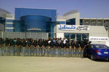 Security forces guard the entrance to Nile University on 17 September Courtesy of Save Nile University group