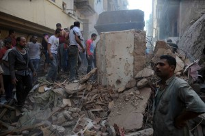 Rescuers try to clear the debris from a recent building collapse in the Shubra area of Cairo (File photo) Mohamed Omar