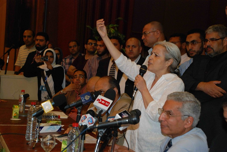 Doctors' syndicate members speak during an exceptional general assembly to discuss strike action Mohamed Omar