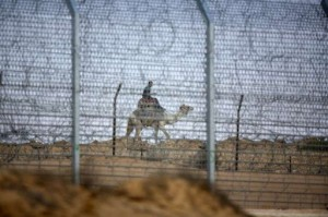 An Egyptian soldier rides a camel while patrolling the Israeli border with Egypt (File photo) AFP PHOTO / MENAHEM KAHANA