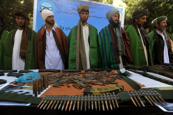 "Former Taliban fighters display their weapons as they join Afghan government forces during a ceremony in Herat province on 18 September 18, 2012. Government authorities banned all Pakistani newspapers claiming ""The papers print Taliban propaganda"" AFP PHOTO / AREF KARIMI"
