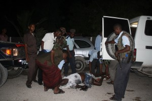 Police gather at the scene of an attack after two suicide bombers blew themselves up in a restaurant in Mogadishu's Hamarweyne district AFP PHOTO / ABDURASHID ABDULLE ABIKAR