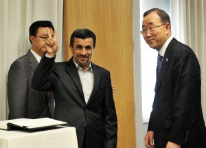 President of Iran Mahmoud Ahmadinejad greets the media after signing a guest book with United Nations Secretary General Ban Ki-Moon before their meeting at UN headquarters in New York AFP PHOTO / STAN HONDA