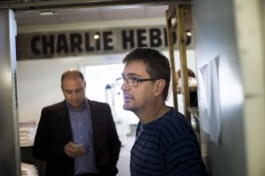 French satirical weekly Charlie Hebdo's publisher, known only as Charb, speaks to journalists on 19 September at the Paris headquarters of the magazine AFP PHOTO / FRED DUFOUR