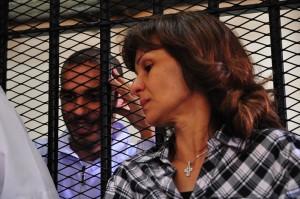 Alber Saber listens to the case against him as his mother stands in front of the defendents cage Hassan Ibrahim