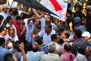 Cairo University staff march onto the Cabinet offices to demand greater wages and representation within the university governing structures Hassan Ibrahim / DNE
