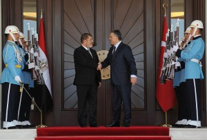 Turkey's President Abdullah Gul (right) welcoming his Egyptian counterpart Mohamed Morsy at the Presidential Palace of Cankaya in Ankara AFP PHOTO / MUSTAFA OZTARTAN