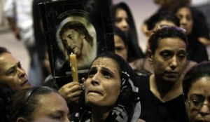 Coptic Egyptians attend a service at the Abbassiya cathedral in Cairo on October 12, 2011 to mourn those killed during recent clashes with security forces AFP PHOTO/MAHMUD HAMS