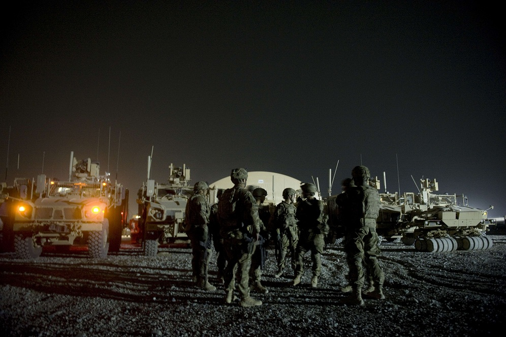 Infantry men attend a briefing prior to embarking on a night patrol from Lindsey foward operating base on 15 September in Kandahar province AFP PHOTO / TONY KARUMBA