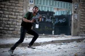 A Syrian rebel aims his weapon during clashes with government forces in the Ezza district of the northern city of Aleppo on 8 September AFP PHOTO / ZAC BAILLIE