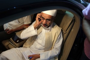 Mohamed al-Megaryef speaks on his mobile phone ahead of visiting wounded Libyan security forces member at the Benghazi hospital on 14 September AFP PHOTO / ABDULLAH DOMA