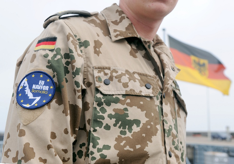 "Badge on the uniform of a German marine reads ""EU NAVFOR Somalia"", an Italian naval helicopter serving as a part of the mission drew small arms fire off the Somali coast AFP PHOTO / INGO WAGNER"
