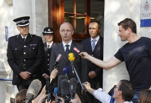 French police Colonel Marc de Tarle (centre) next to Surrey Police Assistant Chief Constable Rob Price (left) speaks to journalists outside Woking Police station, in south-east England, about the ongoing investigation following the shooting of a British family in the French Alps AFP PHOTO / JUSTIN TALLIS