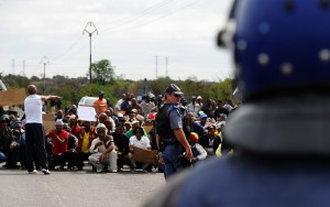 South African police block a march by protesting miners in Rustenburg after a security crackdown in the restive platinum belt AFP PHOTO / ALEXANDER JOE