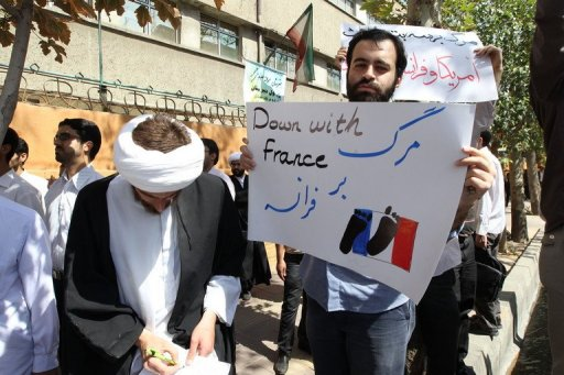 Iranians shout slogans during a demonstration outside the French embassy in Tehran AFP/File, Atta Kenare