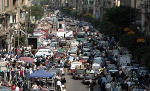 Egyptians mix road and market space in crowded road conditions in Cairo AFP PHOTO / MAHMUD HAMS