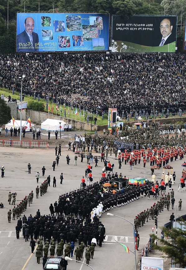 A funeral procession transporting the coffin of Ethiopian Prime Minister Meles Zenawi arrives at Meskel square in Addis Ababa on September 2, 2012. Meles Zenawi died on August 20, 2012. His funeral marks the end of a 21 year rule of the country. AFP PHOTO/ CARL DE SOUZA