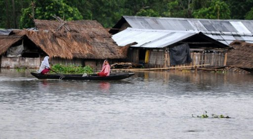 About 2,000 villages had been hit by overflowing waters from the rain-swollen Brahmaputra River AFP, Biju Boro
