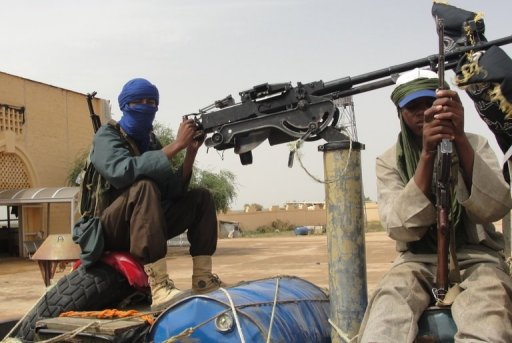 Islamist fighters stand guard near Gao airport AFP/File, Romaric Ollo Hien