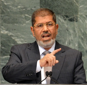 Morsy is willing to enhance the Egyptian/ African relations (file photo) AFP PHOTO / STAN HONDA