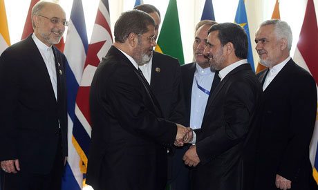 The idea of using Islam as a basis for ruling Egypt was one of the major talking points during the drafting of Egypt's new constitution. Members of the constituent assembly questioned the wording of Article 2 of Egypt's constitution Picture: President Mohamed Morsi (2nd from L) met Iranian President Mahmoud Ahmadinejad at the Tehran summit of Non-Aligned nations.(File Photo) (AFP Photo)
